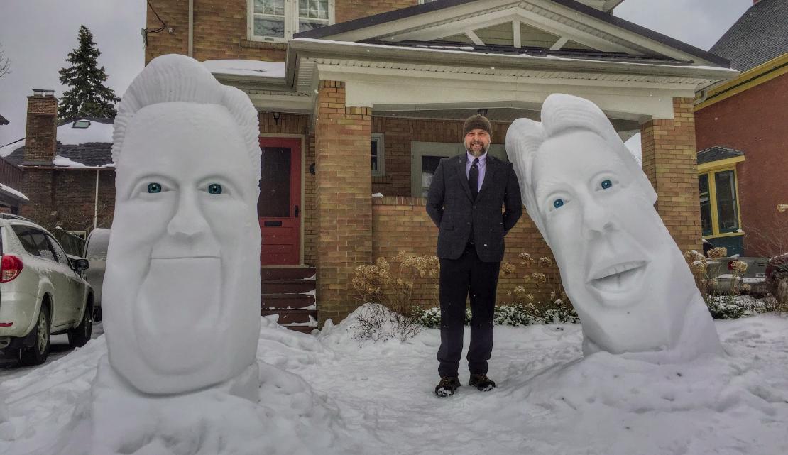 Matt Morris with his giant head snow sculptures